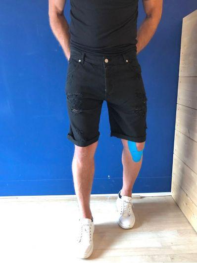 Bermuda jeans strappato